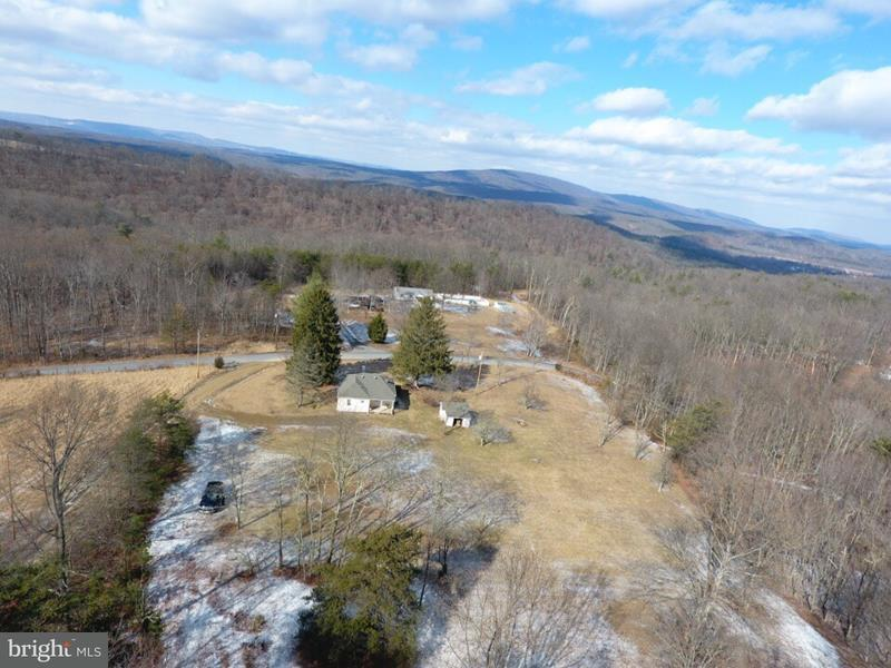 Single Family for Sale at 25 Back Country Rd Paw Paw, West Virginia 25434 United States
