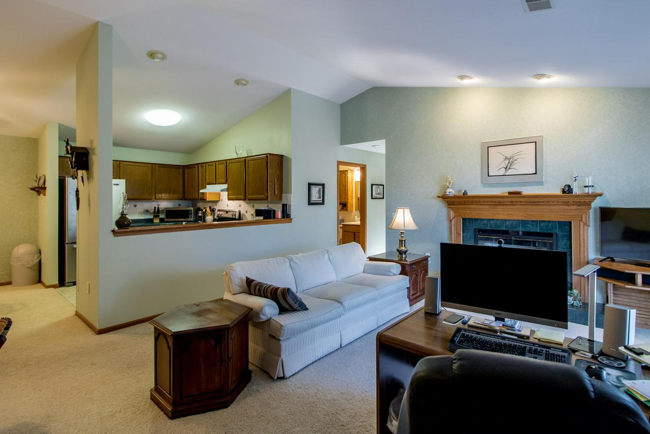 ''Home is the nicest word there is'', Laura Ingalls Wilder. This welcoming condo will provide carefree, convenient living. Spend peaceful evenings curled up near the fireplace or relax on the private balcony. The floor plan is open concept with vaulted ceilings, a large laundry room and triple patio doors. The bonus room could be used as a family room/den, office or guest room with close proximity to one of the full bathrooms. There is plenty of storage space with a 2 car garage, storage closet and walk in attic space.  The location is ideal for nearby shopping, restaurants and Cedarburg Events.