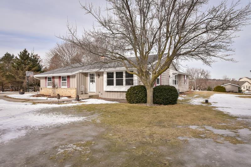 Beautiful ranch home sitting on 1.3 park like acres! Great flowing floor plan, large living/dining room with accent wall, granite counters with tile back splash and real HWF's in centrally located kitchen, family room with natural fireplace, 1.5 updated bathrooms with granite and tile, 3 bedrooms, full basement, large deck and a roof that is only 6 months old.  All appliances included plus a large shed.  A place you can call home for many, many years to come! Interior Video: https://youtu.be/9fOJQaA7b2w