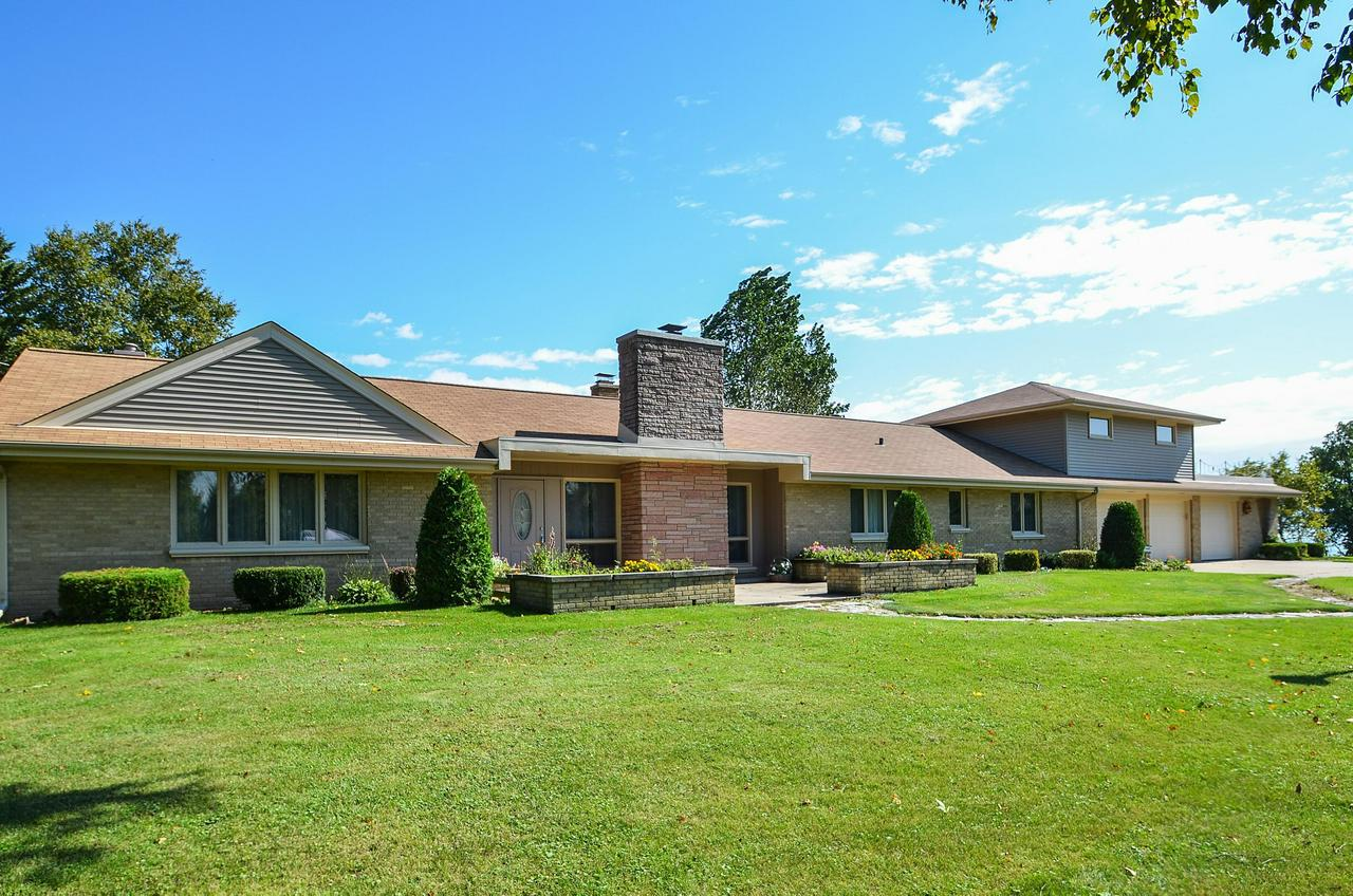 This 1950s classic home sits on one of the most idyllic lots in all of Grafton.  Sweeping panoramic views can be enjoyed from almost every room.  The home offers three bedrooms and two full baths, an eat-in kitchen, natural fireplace, and bright sunroom.  The best surprise awaits you upstairs - a bonus room ready for entertaining.  The bonus room includes a pool table, original wet bar, and large second floor patio.  This home also features a 3.5 car garage, screened in porch, and lovely landscaping throughout.  It is a must see!