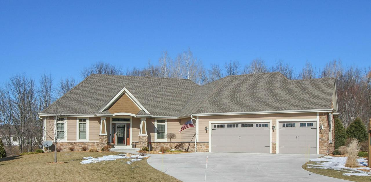 Pristine 4 yr. NEW, 4 BR Exec. Ranch w/office, has everything you could want- Lavish Cook's kitchen boasting double oven, walk-in pantry, Zodiac counters with expansive island, opens to LR w/lovely stone GFP & sunny dining room. An entertainer's dream, no maint. deck overlooking secluded yard, to the finished walk out LL w/family room, wet bar, 4th BR, FULL BATH & bonus (exercise) room. HUGE mudroom w/lockers & laundry.  Master BR offers spacious walk-in closet w/custom organizer.  Supersized finished garage w/tons of storage. Step inside, fall in love and move right in to this stunning home!